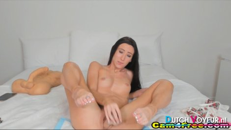 Slim, Brunette Has Fun with Her Toys